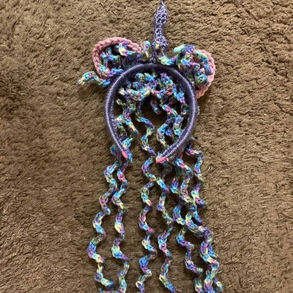 Periwinkle hand crocheted unicorn headband.